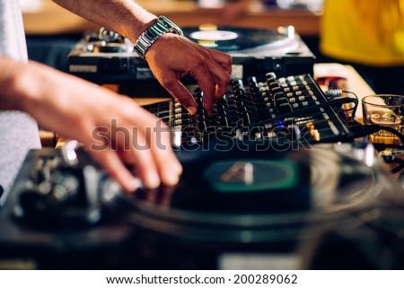 DJ hands on equipment