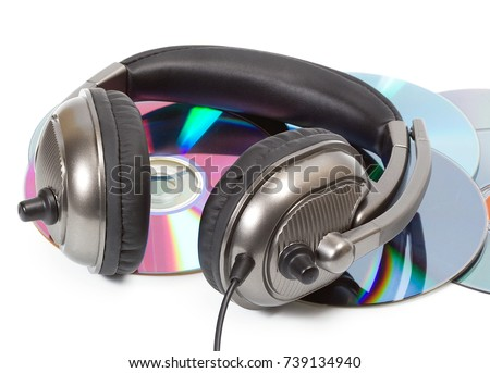 Photo of  dj headphone in digital audio CD dvd disk stack isolated on white background