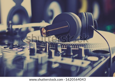 Dj headphones on vinyl record player device in sound recording studio.Professional disc jockey hi-fi sound system on hip hop concert.Listen to the music in hiqh quality with analog audio equipment