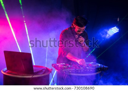 DJ is rhythm music with Controller and mixer. #730108690