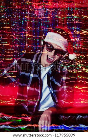 DJ man mixing up some Christmas cheer. Disco lights in the background.