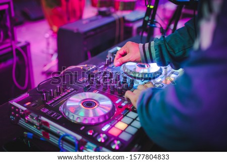 DJ mix tracks at nightclubs at parties, best DJ play, famous CD players at nightclubs during the EDM party, party ideas Сток-фото ©