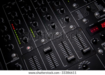 DJ mixer at work in studio