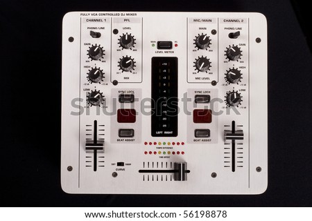 Dj mixer on a black background top view