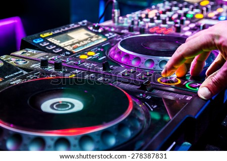 Dj mixes the track in the nightclub at party Сток-фото ©