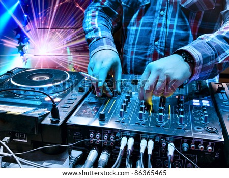 Dj mixes the track in the nightclub at a party  In the