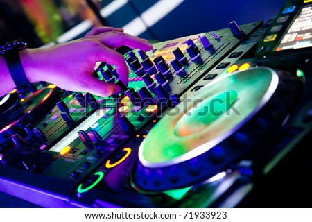 Dj mixes the track with one hand