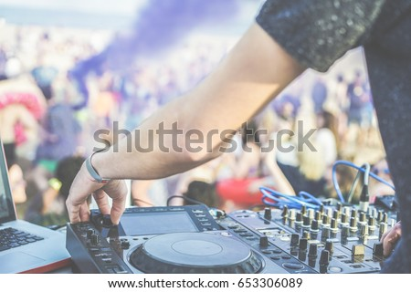 dj mixing at disco party on the ...