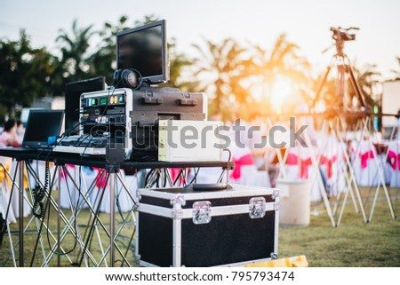 Dj mixing equalizer at outdoor in music party festival with party dinner table. Entertainment and Event organizer concept. Concert and Musical theme #795793474