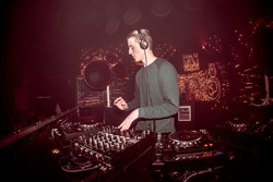 DJ mixing live in a club with led panel decor