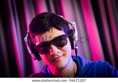 DJ mixing music at disco