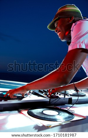 DJ mixing records at a party