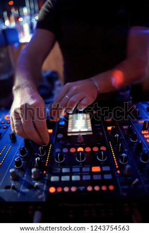 Dj playing disco house progressive electro music at the concert. DJ hands on equipment #1243754563