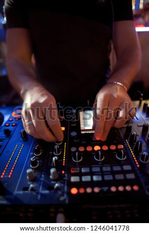 Dj playing disco house progressive electro music at the concert. DJ hands on equipment #1246041778