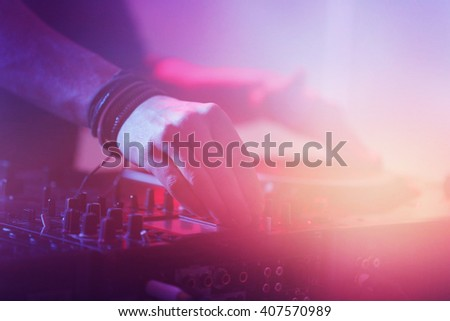 DJ playing music at mixer closeup
