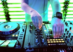 Dj playing the track in the nightclub at a party