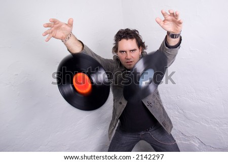 DJ throwing two vinyl records