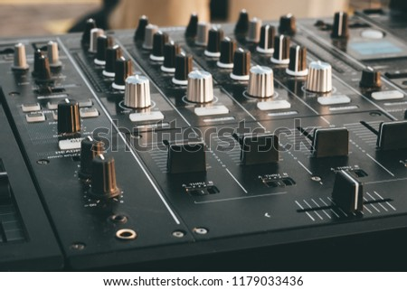 DJ turntable deck mixer close up, sound equipment, audio control panel for party, night clubs or music studio, toned