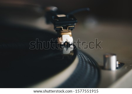 Dj turntable deck.Vinyl record player device on close up.Professional disc jockey audio equipment playing disc with musical tracks.Listen to classic music in high quality with hi-fi sound system