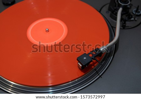 dj turntable old style with coloured red vinyl