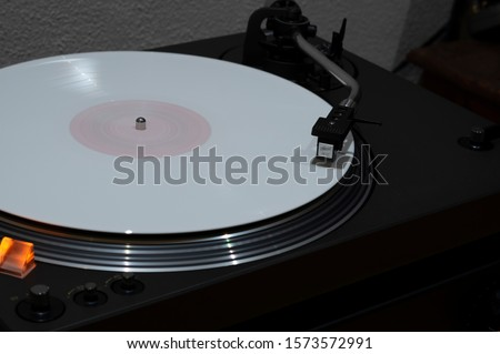 dj turntable old style with coloured white vinyl