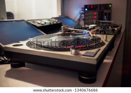 DJ turntable playing vinyl