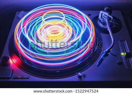 DJ turntable spinning colorful lights