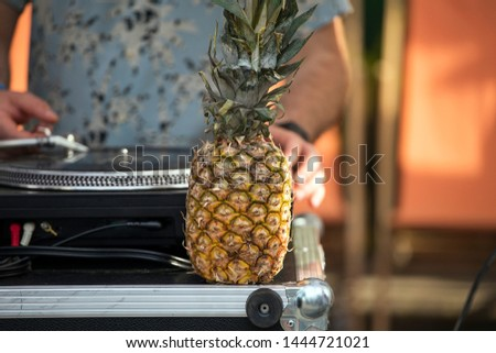 DJ turntable with pineapple fruit, summer party