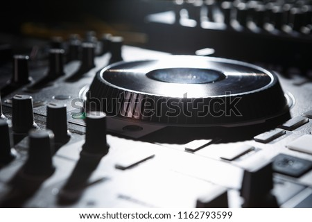 Dj turntables player device on concert stage.Professional digital disc jockey midi turn table controller
