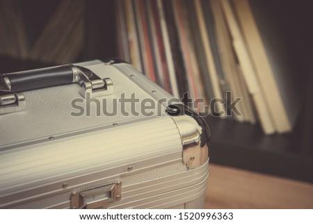 Dj vinyl records in transport case.Sound recording studio gear.Professional disc jockey audio equipment.Vintage turn table record player box.Retro hi-fi sound system for musician #1520996363