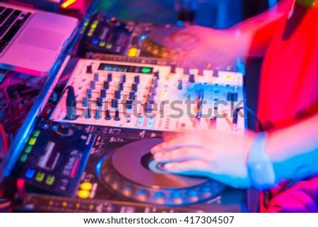 DJs are turntablism turntables plate mixer night party pub Motion blur abstract background.