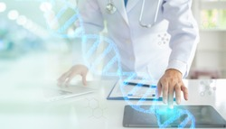 DNA Digital healthcare and network connection with doctor touching hologram modern virtual screen interface on tablet. medical technology concept.