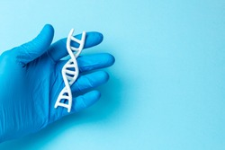 DNA helix research. Concept of genetic experiments on human biological code DNA. Scientist holds DNA helix