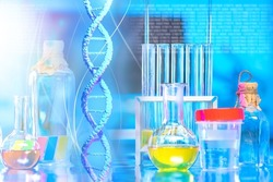 DNA spiral on background of laboratory. DNA spiral near medical flasks. Test tubes in genetic laboratory. DNA research concept. Experiments in field of genetic engineering. Genetic mutation research