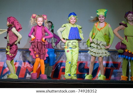 """DNEPROPETROVSK, UKRAINE - APRIL 9: Children's fashion theater """"Mal-a-hit"""" presents a collection of """"Gogoriki"""" at the """"Fashion town"""" festival  on April 9, 2011 in Dnepropetrovsk, Ukraine"""