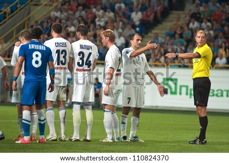 DNEPROPETROVSK, UKRAINE - AUGUST 11: Dmitry Kutakov referee (R) at the Uk. Championship football game FC Dnepr vs. FC Hoverla on August 11 , 2012 in Dnepropetrovsk, Ukraine