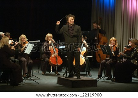 DNEPROPETROVSK UKRAINE DEC.17 Four seasons Chamber Orchestra main conductor Druzelub Yanakiev perform music of Mozart Elgar Brittain Dvorak on Dec 17 2012 in Dnepropetrovsk Ukraine