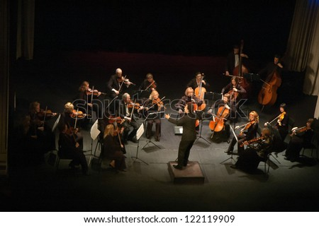 "DNEPROPETROVSK, UKRAINE - DEC.17: ""Four seasons"" Chamber Orchestra - main conductor Druzelub Yanakiev perform music of  Mozart, Elgar, Brittain, Dvorak on Dec. 17, 2012 in Dnepropetrovsk, Ukraine #122119909"