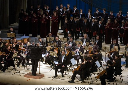 "DNEPROPETROVSK, UKRAINE - DECEMBER 26: ""Christmas Oratorio"" by Hilarion  performed by Symphony Orchestra and chorus of the Kharkov Philharmonic on December 26, 2011 in Dnepropetrovsk, Ukraine"