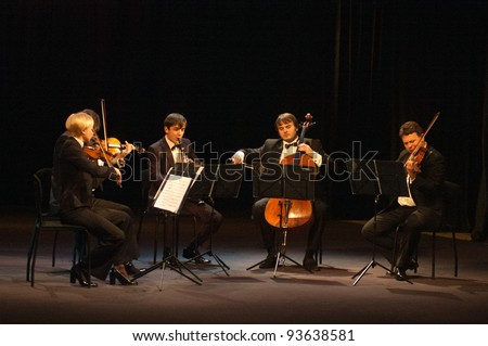 DNEPROPETROVSK, UKRAINE - DECEMBER 19: Members of the QUINTA Orchestra performed music of  Williams on December 19, 2011 in Dnepropetrovsk, Ukraine