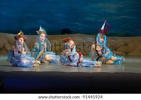 "DNEPROPETROVSK, UKRAINE - DECEMBER 17: Unidentified girls, ages 6-7 years old, perform musical spectacle "" Red Sails"" on December 17, 2011 in Dnepropetrovsk, Ukraine"