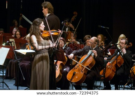 """DNEPROPETROVSK, UKRAINE - FEBRUARY 28: """"Violin Concerto"""" by Peter Tchaikovsky performed by Maria Shamshina and Academic Symphony Orchestra on February 28, 2011 in Dnepropetrovsk, Ukraine"""