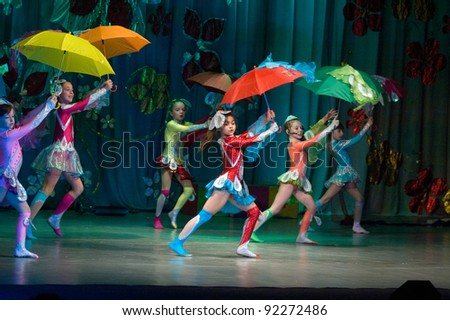 """DNEPROPETROVSK, UKRAINE - JUNE 4: Unidentified Children, ages 8-10 years old, perform musical spectacle """"Neznaika"""" on June 4, 2011 in Dnepropetrovsk, Ukraine"""