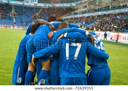 DNEPROPETROVSK, UKRAINE - MARCH 6: Footballers FC Dnepr celebrate goal during their Uk. Championship game against FC Tavriya on March 6 , 2011 in Dnepropetrovsk.