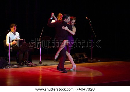 DNEPROPETROVSK, UKRAINE - MARCH 26: The dancers Gimena Aramburu and Juan Fossati (Argentina) at Stars of Argentine Tango show on March 26, 2011 in Dnepropetrovsk, Ukraine.