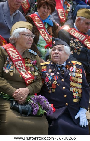 DNEPROPETROVSK, UKRAINE - MAY 9: Elderly veterans of WWII sit and watch parade on annual Victory Day, May, 9, 2010 in DNEPROPETROVSK, UKRAINE.