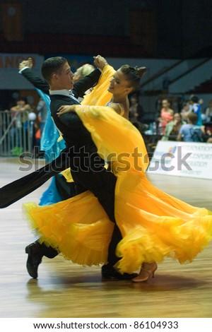 DNEPROPETROVSK, UKRAINE - SEPTEMBER 24: An unidentified dance couple in a dance pose during World Dance Competition DNEPR CUP 2011? on September 24, 2011 in Dnepropetrovsk, Ukraine.