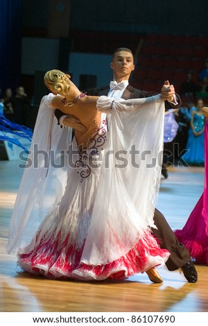 DNEPROPETROVSK, UKRAINE - SEPTEMBER 24: An unidentified dance couple in a dance pose during World Dance Competition ?DNEPR CUP 2011? on September 24, 2011 in Dnepropetrovsk, Ukraine.