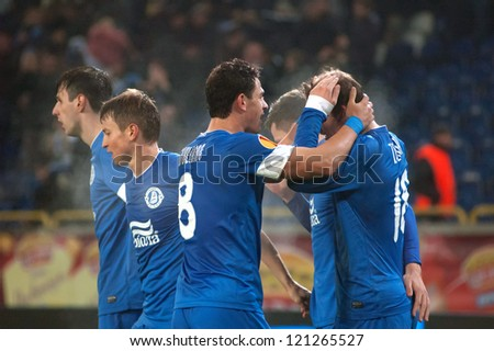 DNIPROPETROVSK, UKRAINE - DEC. 6: FC Dnipro Dnipropetrovsk players celebrate scoring during the UEFA Europa League group stage match against FC AIK on December 6, 2012 in Dnipropetrovsk, Ukraine