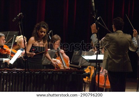 DNIPROPETROVSK, UKRAINE - JUNE 22, 2015: Famous performer Helen Shabelsky (marimba) and  FOUR SEASONS Chamber Orchestra - main conductor Dmitry Logvin perform at the State Russian Drama Theatre